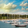 Beautiful port at dusk with small boats anchored — Stock Photo