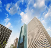 Skyscrapers, upward view from street level — Stock Photo