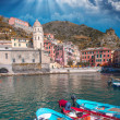 Colorful boats in the quaint port of Vernazza — Stock Photo #40350213
