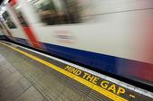Gap sign with speeding train — Stock Photo