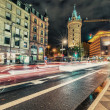 City lights at night with car light trails — Stock Photo