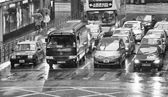 Chaotic city traffic with red taxi cabs — Foto Stock