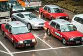 Chaotic city traffic with red taxi cabs — Stock Photo