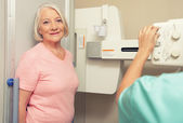 Woman patient ready to be scanned at X-Ray machine — Stock Photo