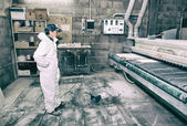 Manufacture process of carpenter work with wood at machining cen — Stock Photo