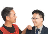 Asian worker and boss joking and smiling together, happy with re — Stock Photo