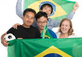 Happy Brazilian football fans with flags and soccer ball, isolat — Stock Photo