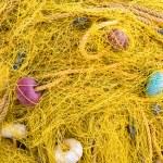 Yellow fishing net — Stock Photo #48687579
