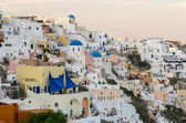 Oia village homes at sunset — Stock Photo