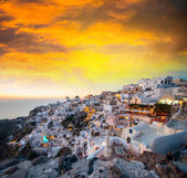 Mediterranean village of Oia at dusk, Santorini Island - Greece — Stock Photo