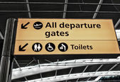 All departure gates and Toilets sign in the airport — Stock Photo