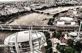 LONDON - SEPTEMBER 29, 2013: London Eye Cabin and cityscape. Lon — Stock Photo