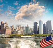 American flag with New York skykine on background — Stock Photo