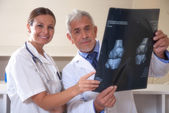 Doctors examining x-ray test results — ストック写真