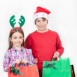 Happy kids wearing Christmas dress holding gifts, isolated on wh — Stock Photo #50994875
