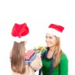 Baby girl giving Christmas gift to her happy mother, isolated on — Stock Photo