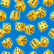 Vector dice seamless background. Yellow on blue — Stock Vector