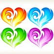 Set of burning vector heart. Red, blue, green and purple symbol - Stock Vector