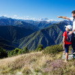 Man and young boy standing in a mountain meadow — Fotografia Stock  #12479581