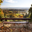 Bench in a park with views of the countryside. - Stock Photo