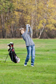 Young golfer swing — Stock Photo