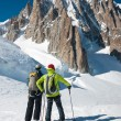 Stock Photo: Skiers in front of breathtaking view of Mont Blanc de Tacul