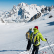 Stock Photo: Skiers on big glacier of Vallee Blanche.