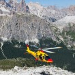 Mountain rescue with a Helicopter in the Alps. — Stock Photo #30276153