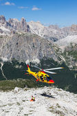 Mountain rescue with a Helicopter in the Alps. — Stock Photo