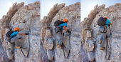 Young boy climbing a via ferrata in the Italian Dolomites. — Foto de Stock