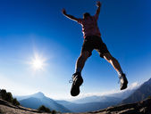 Man jumping in the sunshine against blue sky — Stock Photo