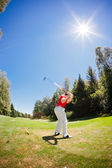 Golf player performs a swing — Stock Photo