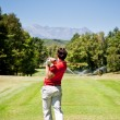 Golf player performs a tee shot — Stock Photo