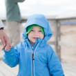 Little boy holding moms hand. — Stock Photo