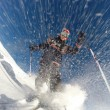 Downhill alpine skiing at high speed on powder snow. — Photo