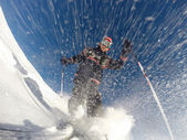 Downhill alpine skiing at high speed on powder snow. — Stock Photo
