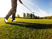 Golfer performs a golf shot from the fairway. — Stock Photo