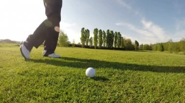 Golfer performs a golf shot from the fairway. — Stock Video