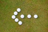 Golf balls arrow — Stock Photo