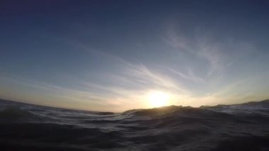 Swimming in the sea at sunset. — Stock Video