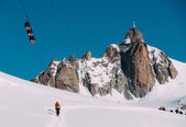 The Aiguille du Midi peak with Panoramic Mont-Blanc cable car — Stock Photo