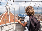Boy looking through a sightseeing binoculars the Dome of Basilic — Stock Photo