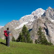 Hiker admiring mountain landscape around Mont Blanc, Courmayer — Zdjęcie stockowe