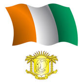 Wybrzeże Kości Słoniowej falisty flaga i herb — Wektor stockowy
