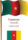 Cameroon wavy flag and coordinates — Stock Vector