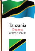 Tanzania wavy flag and coordinates — Stock Vector