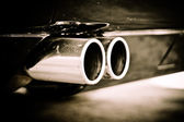 Close up detail of a twin exit tail pipe — Stok fotoğraf