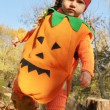 Baby dressed in a pumpkin costume — Stock Photo