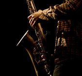 Warm photo of the male saxophonis playing in sax — Стоковое фото