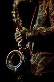 Stylizowane zdjęcie mężczyzna saxophonis gra w saksofon — Zdjęcie stockowe